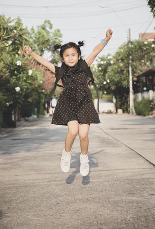 asian children jumgping mid air in home village Stock fotó