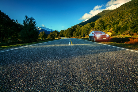 tourist drive traveling in aspiring national park southland new zealand Stock Photo
