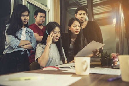 asian younger freelance team concentrate on working project in computer monitor Banco de Imagens