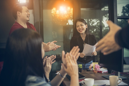 asian freelance team meeting with happiness in modern home office