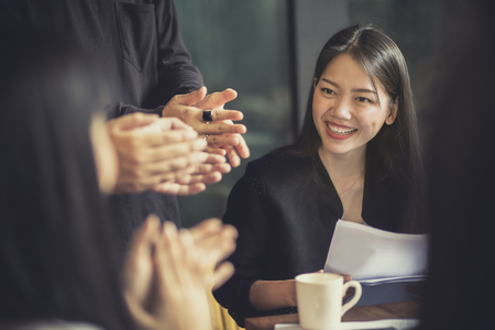 smiling face of asian attractive woman working in office meeting room