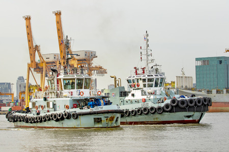 bangkok thailand - july14,2015 : tug boat approaching on duty in chaopraya river,klong tuey port most important water transportation in heart of thailand capital Editorial