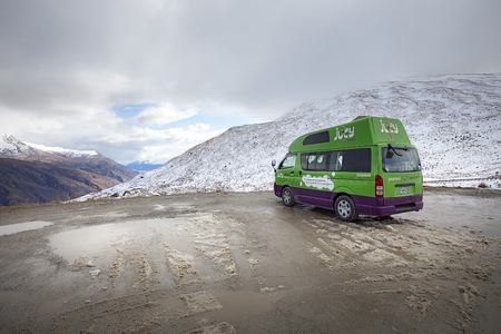 queenstown new zealand - september5,2015 : juicy condo van parking at viewpoint of crown range road from wanaka town to queenstown southland new zealand ,juicy one of most popular car rent company in new zealand