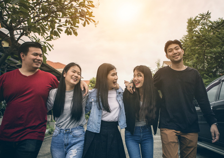 group of asian younger man and woman relaxing location Stock Photo