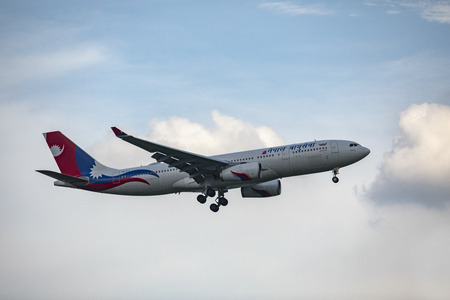 bangkok thailand - october1,2018 : nepal airline plane approach for landing to suvarnabhumi airport