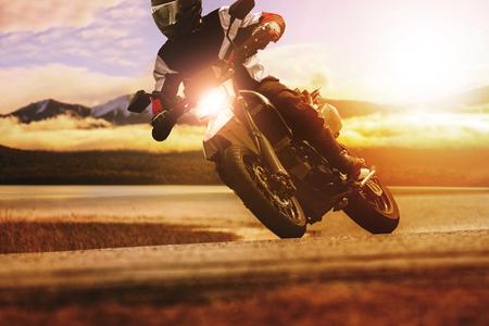 man riding sport motorcycle on asphalt highway