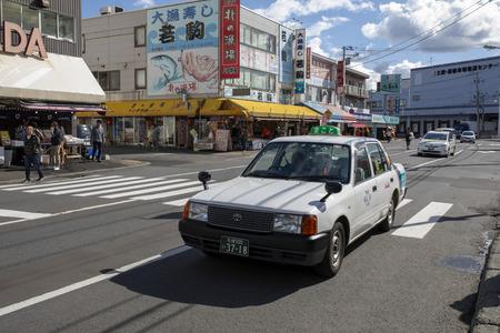 hokkaido japan - october8,2018 : old toyota taxi driving on Soen-Hassamu Dori road jogai seafood market hokkaido japan Editorial