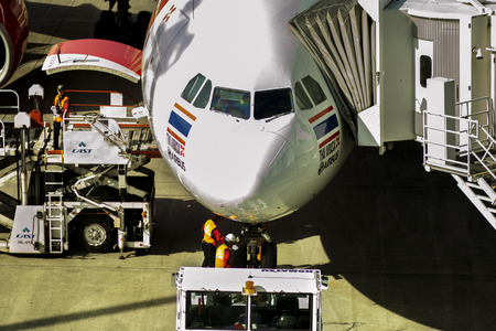 hokkaido japan - october9,2018 : airport technician checking on thai airasia plane before departure from new shintose airport hokkaido japan