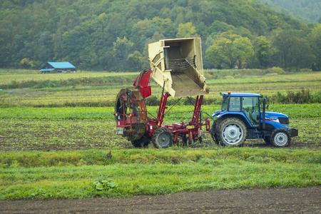 hokkaido japan - october7,2018 : agriculture vehcle  parking in cultivation area of hokkaido farmer