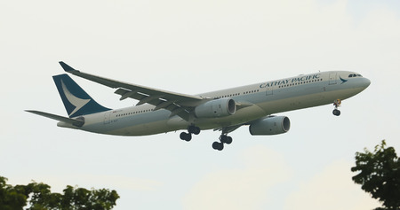 bangkok thailand - october1,2018 : cathay pacific airline plane approach for landing to suvarnabhumi airport Фото со стока - 110411129