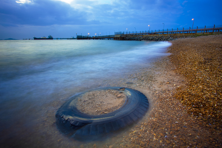 truck tire and sea scape at dusk