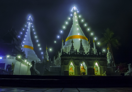beautiful night shot of phra that doi kong moo most important religion traveling destination in maehongsorn province northern of thailand Banco de Imagens