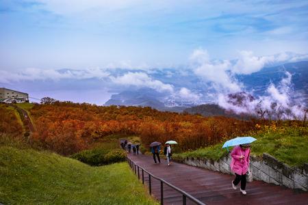 hokkaido japan - october6,2018 : unidentified tourist walking in walking way to top mountain viewpoint in showa-shinzan  in Shikotsu-Toya National Park one of most popular traveling destination japan Standard-Bild - 113413721