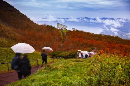 group of tourist walking in path way of showa-shinzan and usu ropeway one of most popular traveling destination hokkaido japan Standard-Bild - 113429397