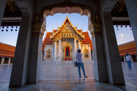 bangkok thailand - october27,2018 : tourist taking a photograph in wat benchamabophit one of most popular traveling destination in bangkok thailand Editorial