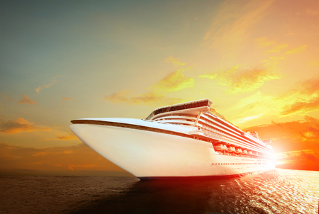 luxury cruising ship over sea with sunset sky background
