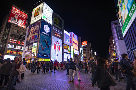 osaka japan - november6,2018 : large number of tourist attraction to dotonbori canal district place of glico brand banner sign on building wall