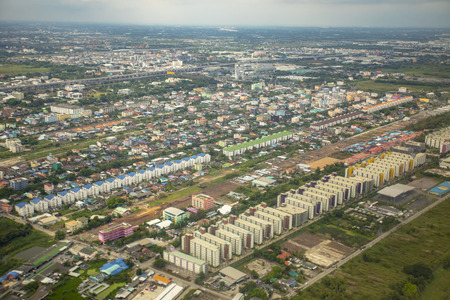high angle view of condominium building and home village over outskirt of bangkok thailand capital