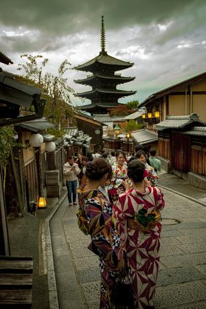 kyoto japan - november9,2018 : japanese woman wearing kimono old traditon clothes taking photograph at yasaka shrine street, yasaka shine pagoda is one of most popular traveling destination in kyoto j