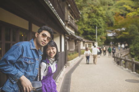 younger asian man and woman traveling with happiness in japan destination Stock Photo
