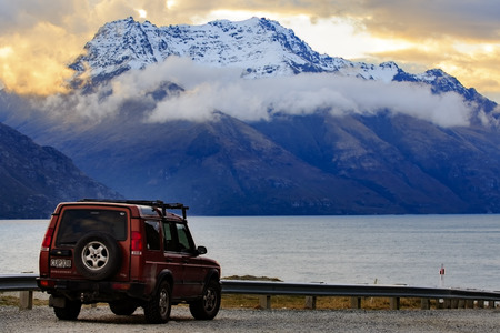 queenstown new zealand - august 30,2015 : suv vehicle parking at lookout scene parking beside pukaki lake in queenstown southland new zealand,queenstown is principle traveling hub of tourist in southland of new zealand southern Editorial
