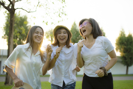 three asian woman laughing together with happiness emotion