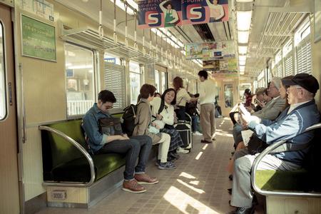 osaka japan - november5,2018 : unidentified japanese people boarding on hunkyo trains line in osaka japan Editorial