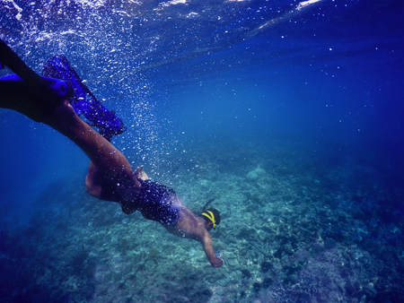 man free dive  to under sea water for coral photography