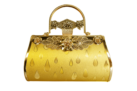 golden color of woman luxury hand bag isolate white background Reklamní fotografie