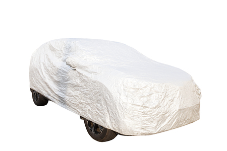 passenger car parking with plastic protective cover isolate white background