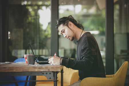 left handed freelance man write project in home working office