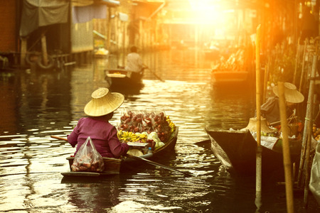 thai fruit seller sailing wooden boat in thailand tradition floating market Stock Photo - 119350317