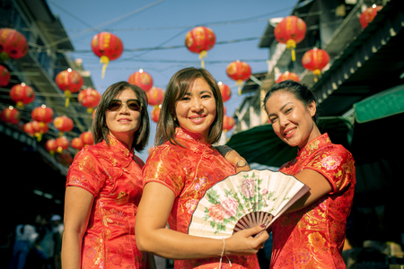 three asian woman wearing chinese tradition clothes toothy smiling face in yaowarat street china bangkok thailand Stock fotó - 119350582