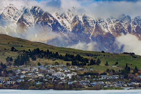 residence and rural farm against high mountain in queenstown southland new zealand Stock Photo