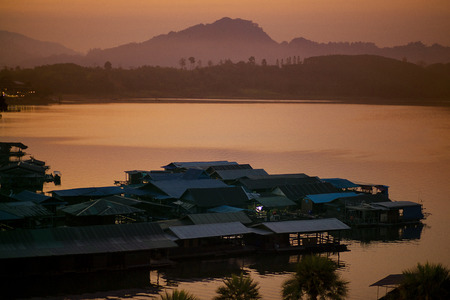 morining light of floating home in sangklaburi lake western terri of kanchanaburi one of most popular traveling destination in thailand