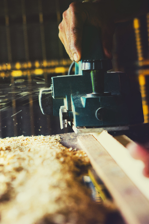 close up wood drill machine working  in home work shop Stock Photo