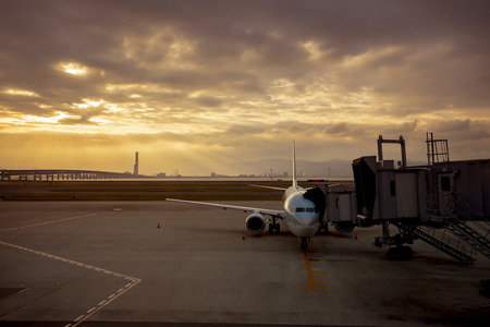 passenger plane preparing for departure from airport terminal early morning