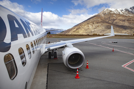 queenstown new zealand - september6,2015 : qantas airline plane approach for departure from queenstown airport southland new zealand