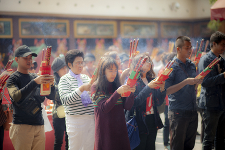 hongkong china - march16,2019 : large number of asian people praying to buddhist shrine with incenses in hongkong city religion traveling destination Editorial