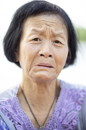 close up face of asian senior woman crying emotion