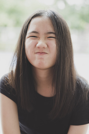 close up kidding face of cheerful asian teenager with long brown hair Stockfoto