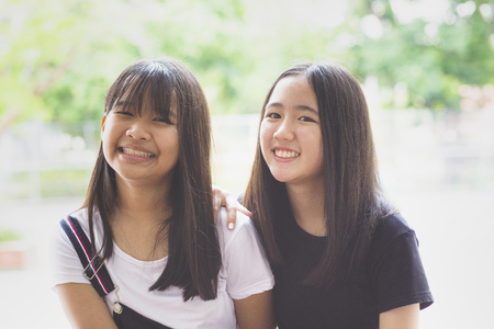 toothy smiling face happiness emotion of two asian teenager Stockfoto