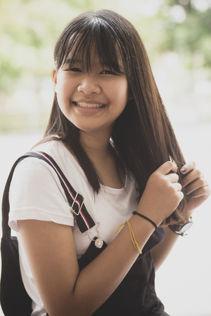 portrait of asian teenager toothy smiling face happiness emotion