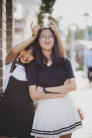 cheerful of two asian teenager playing with relaxing emotion Stockfoto
