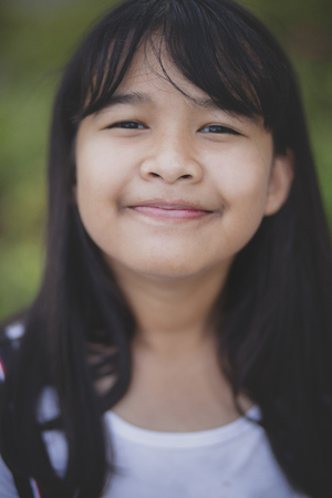 headshot shallow depth of field of  asian teenager smiling face Reklamní fotografie