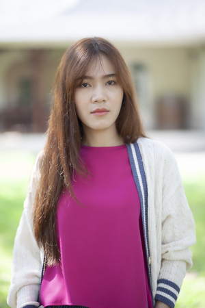 portrait face of beautiful asian younger woman standing outdoor