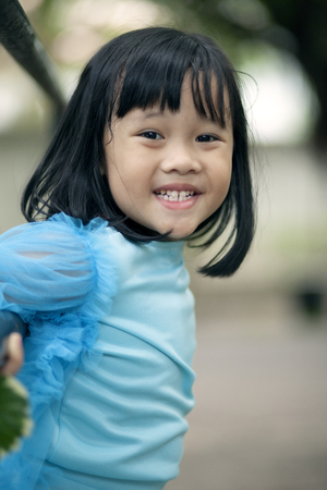 close up face asian girl children toothy smiling face happiness emotion looking to camera