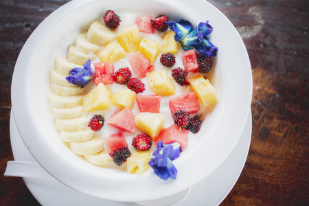fresh tropical fruit dressing on yougurt milk morning fod meal