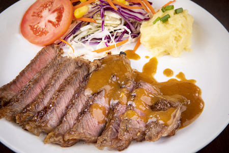 beef steak sliced  ready to eating on white plate Imagens