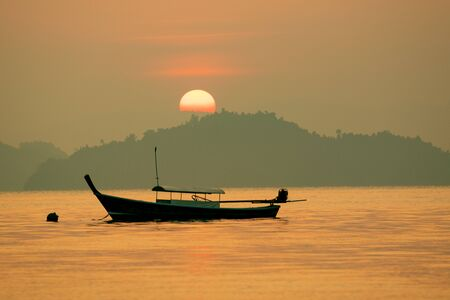 beautiful sun rising sky over abandon island in andaman sea thailand 스톡 콘텐츠